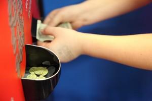Child Putting Money in Arcade Token Change Machine free creative commons